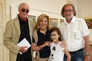 La giovane artista Margherita con gli amici pittori